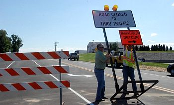 Pioneer Road Ribbon Cutting_sign removal