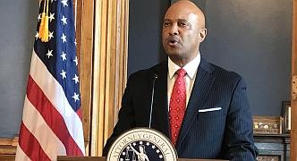 Attorney General Hill behind podium