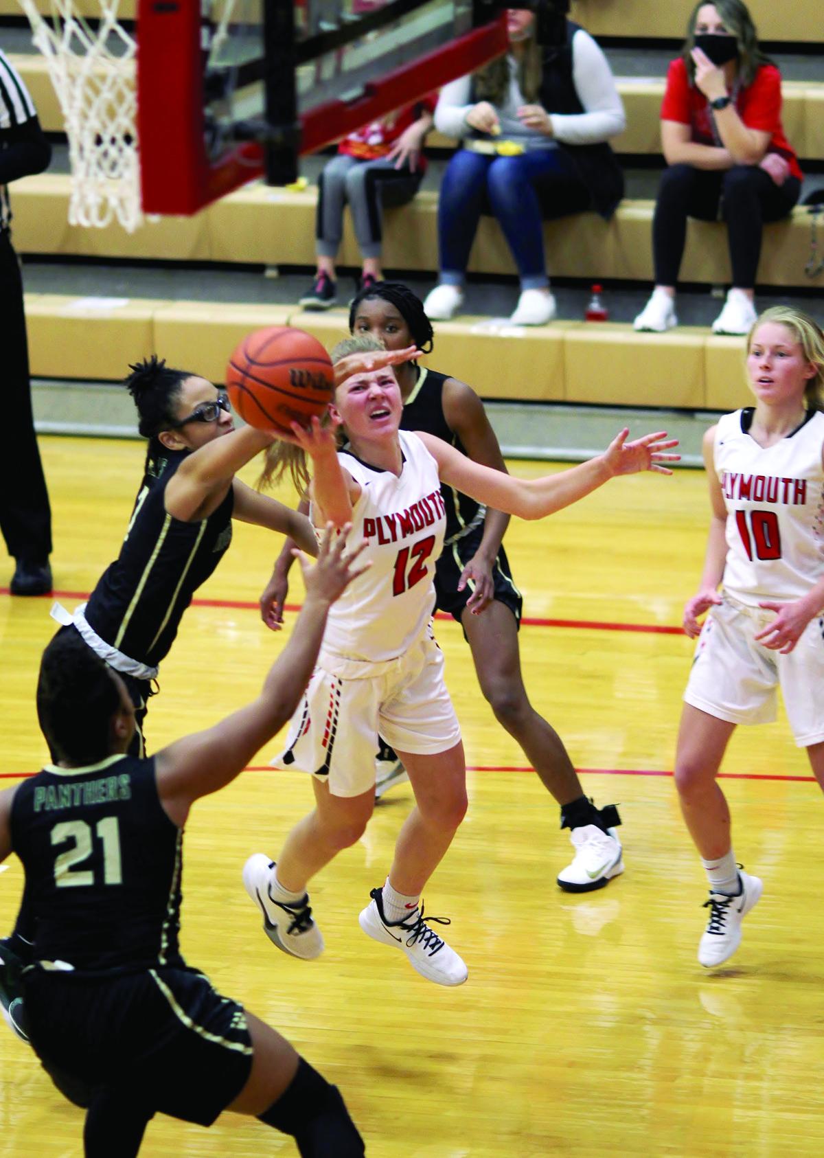 Lindsay Janus goes up for a shot under the basket